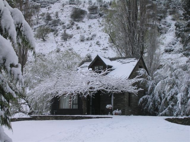 Cherry Tree House covered in snow - boutique accommodation Queenstown