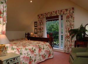 Floydies Room - King bedroom with large balcony overlooking the river